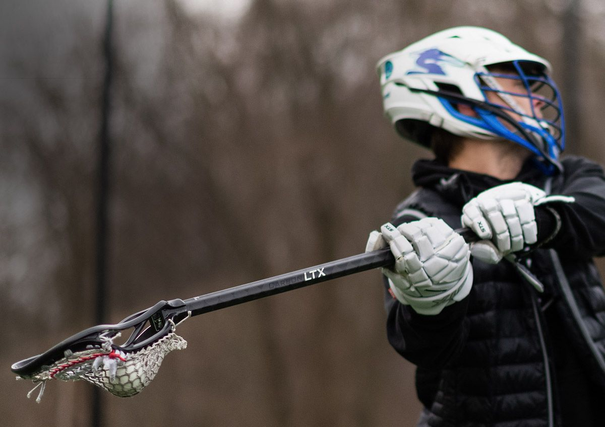 A field lacrosse player using a stick featuring the ECD Carbon LTX.