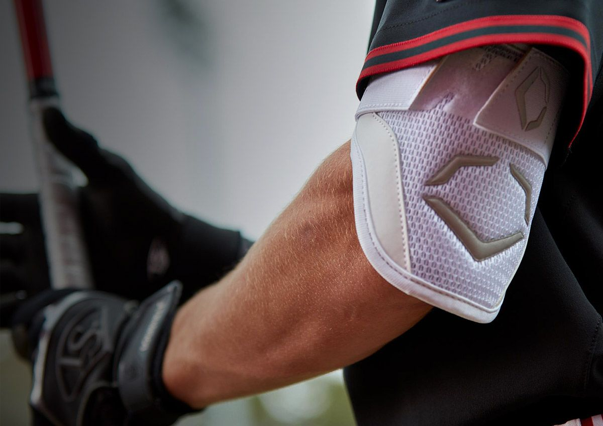 Baseball player holds a bat at the plate wearing the evoshield pro-SRZ batter's elbow guard.