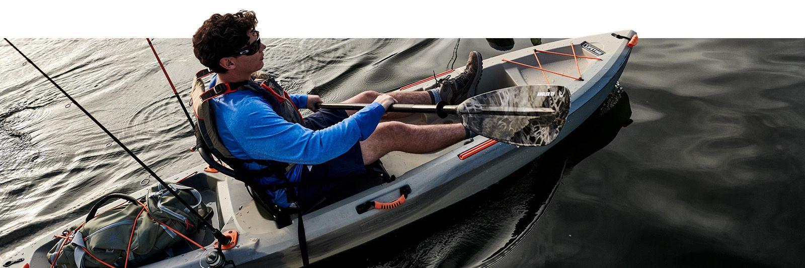 Image of a fisherman propelling along in a Lifetime Teton Pro Angler kayak.