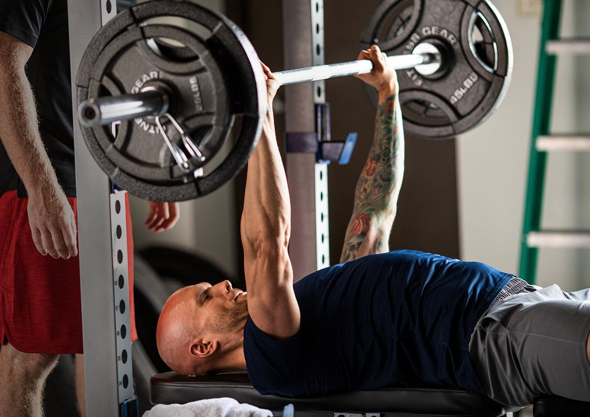 A man doing bench presses.
