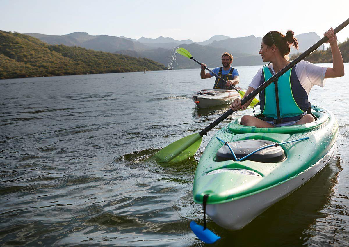 A couple enjoys time in their kayaks.