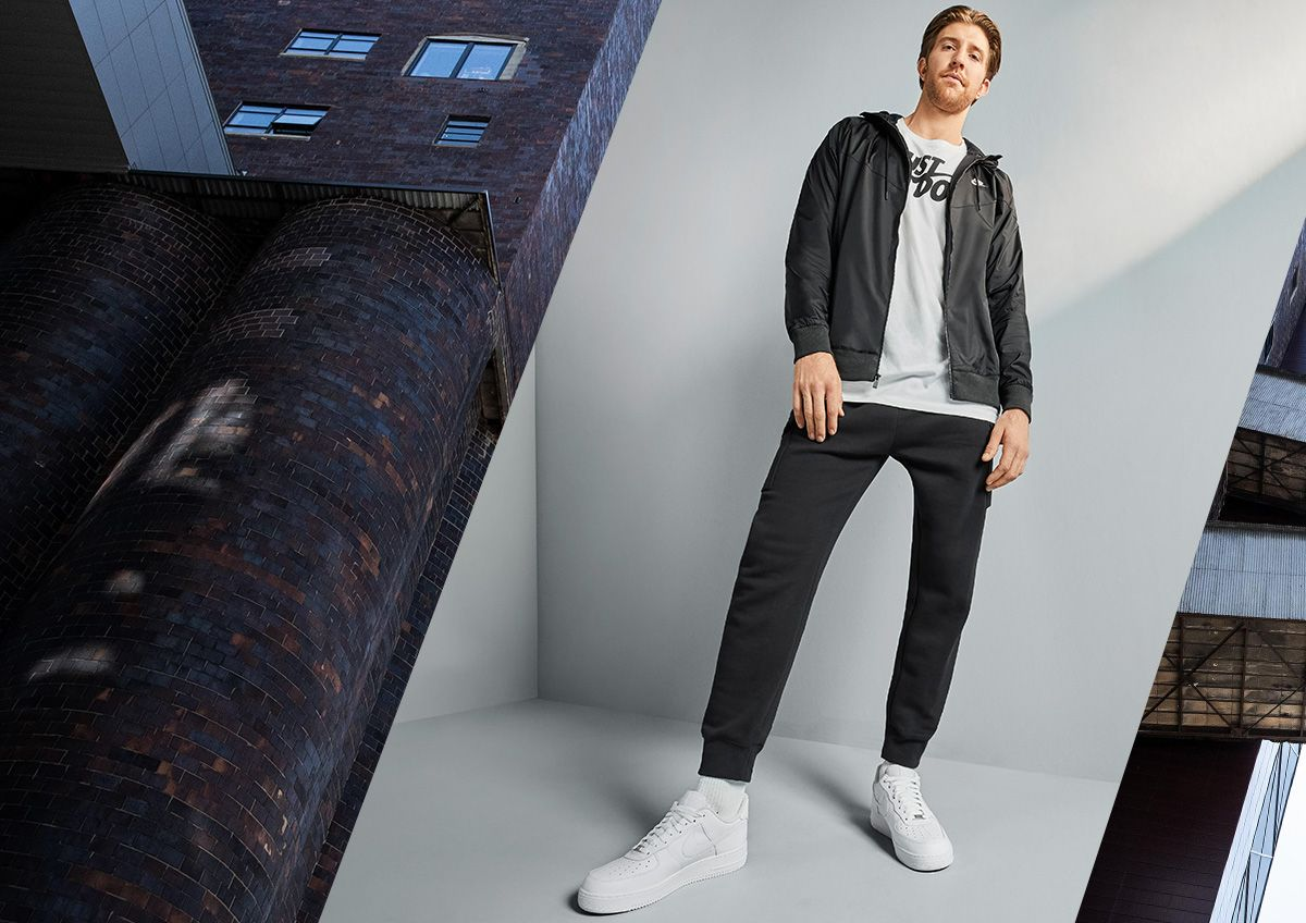 Image features a very tall man wearing stylish activewear.