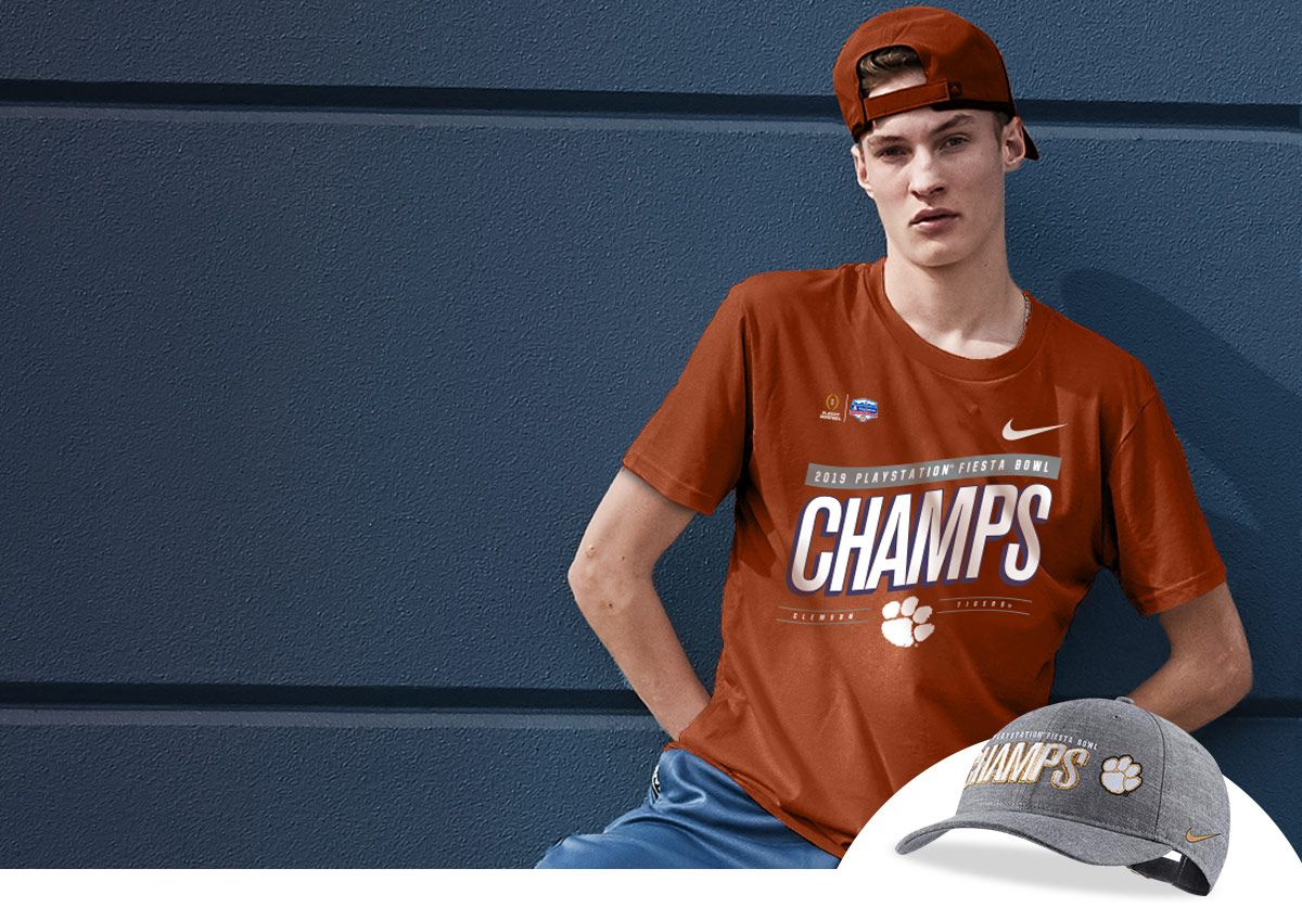 Male fan wearing Fiesta Bowl championship T-shirt for the Clemson Tigers.