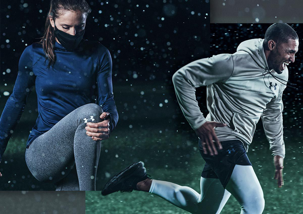 A man and a woman training in snow wearing ColdGear