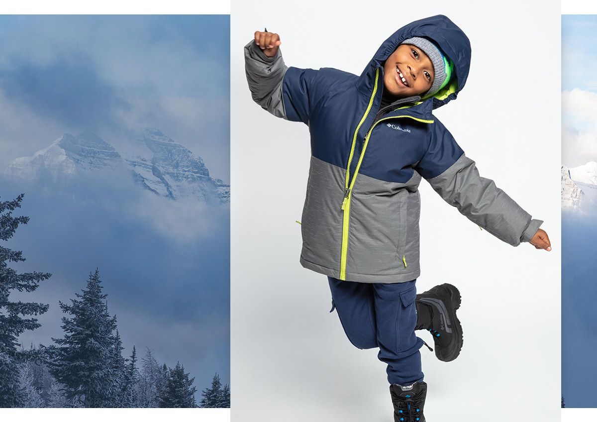 A young boy wearing a heavy winter jacket.