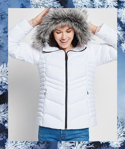 A woman wearing an Alpine Design jacket.