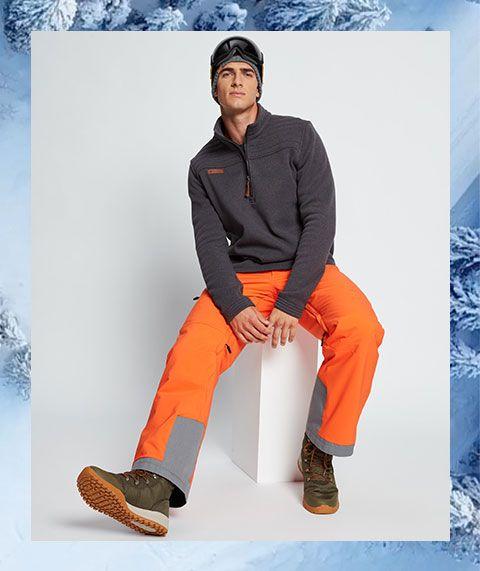 A man sitting in ski apparel.