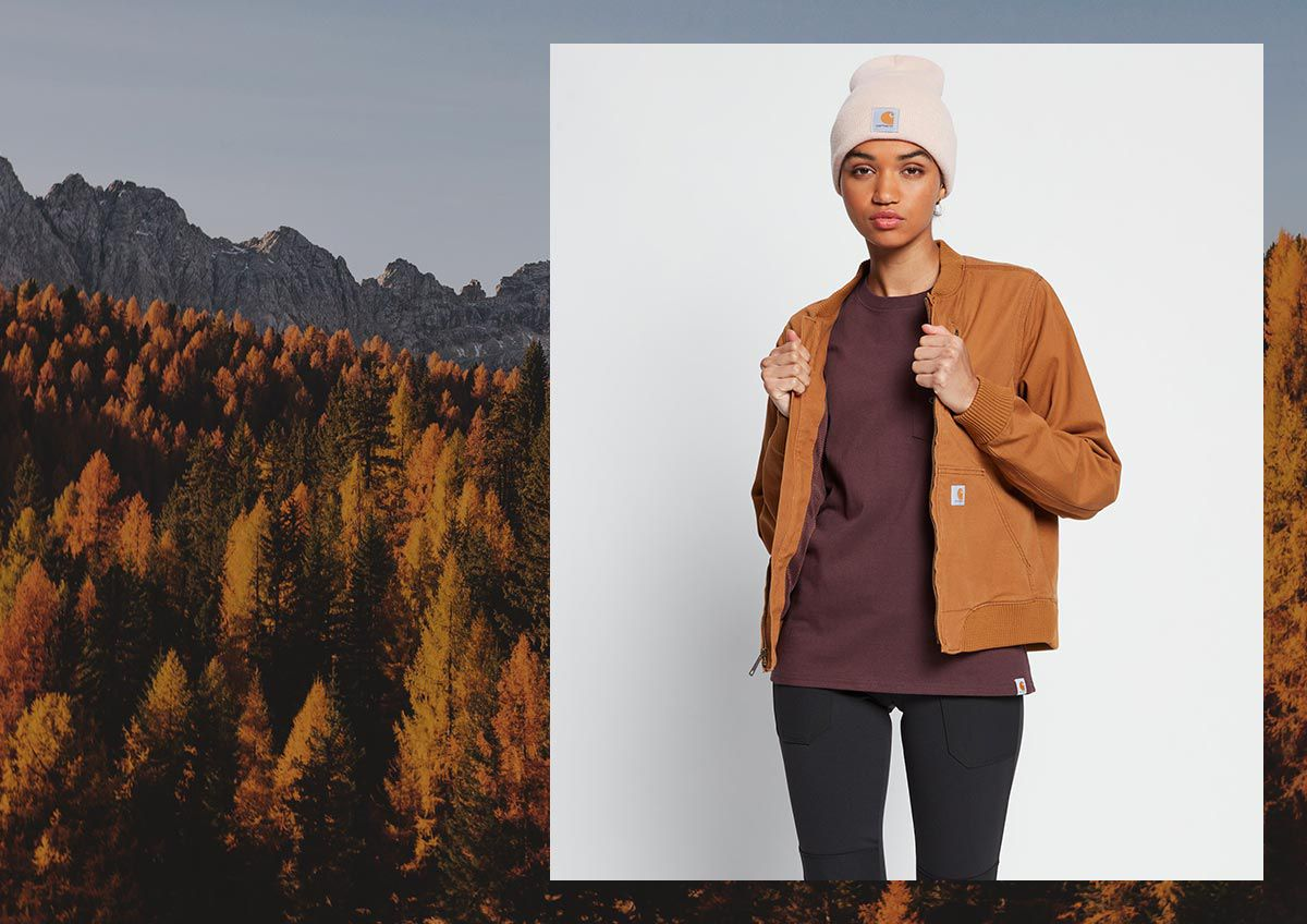 Trees with fall leaves and a woman wearing fall clothes.