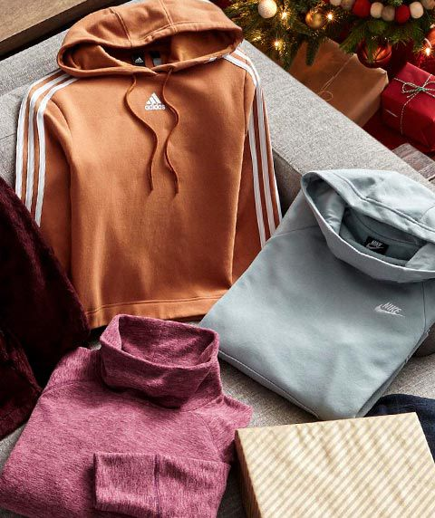 An adidas Women's Post Game Cropped Hoodie, Nike Women's Sportswear Essential Funnel Neck Fleece Hoodie, and a DSG Women's Polar Fleece Funnel Neck Heather Sweatshirt.