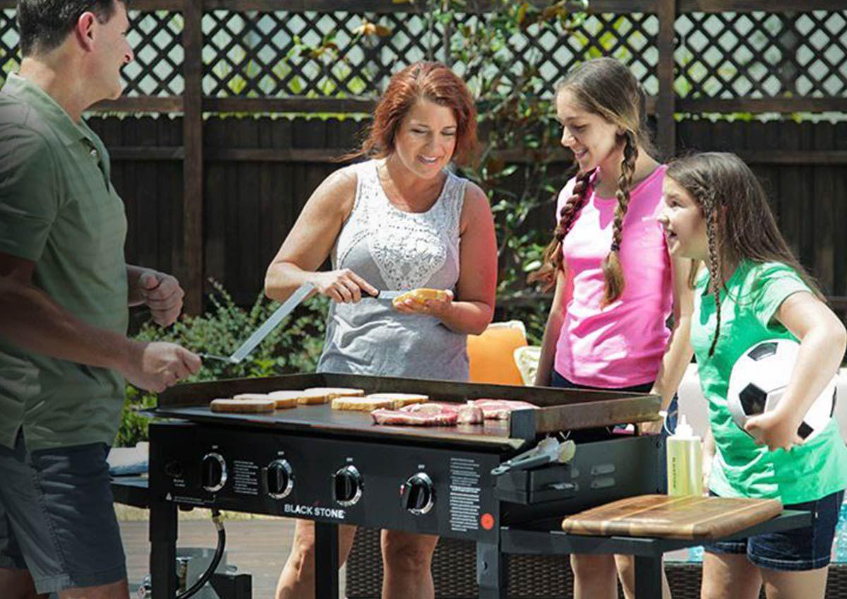 A family enjoys a cookout in their backyard.