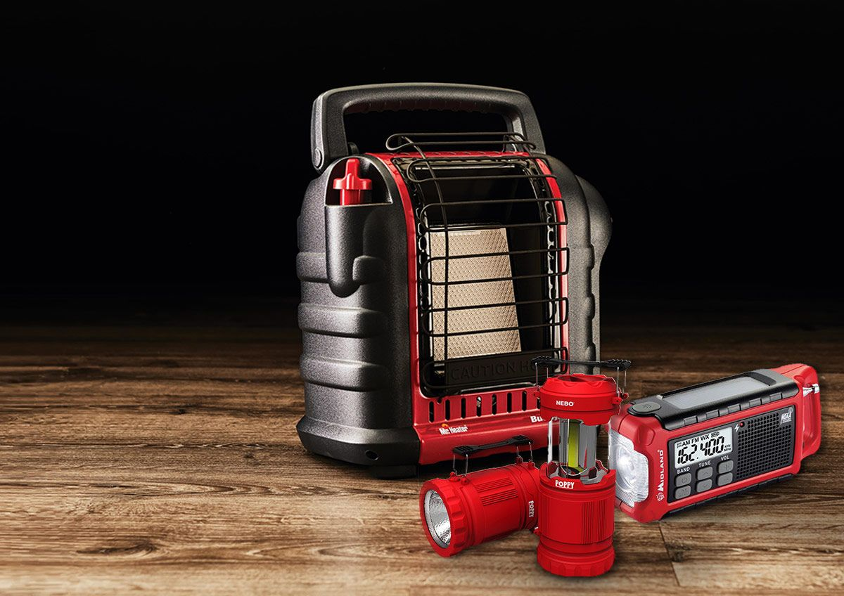 A collection of common disaster relief supplies including a portable heater, two-way radios and flashlights.