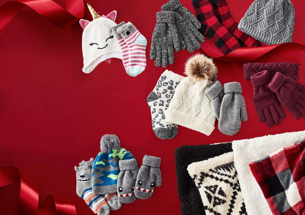 Image features a collection of comfy socks, hats, blankets and other cabin-inspired cozies.