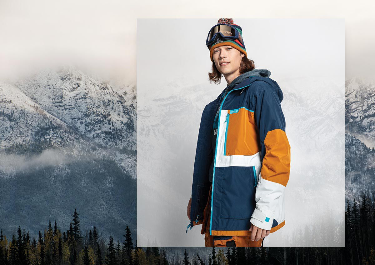 Mountains and a man wearing Burton ski apparel.