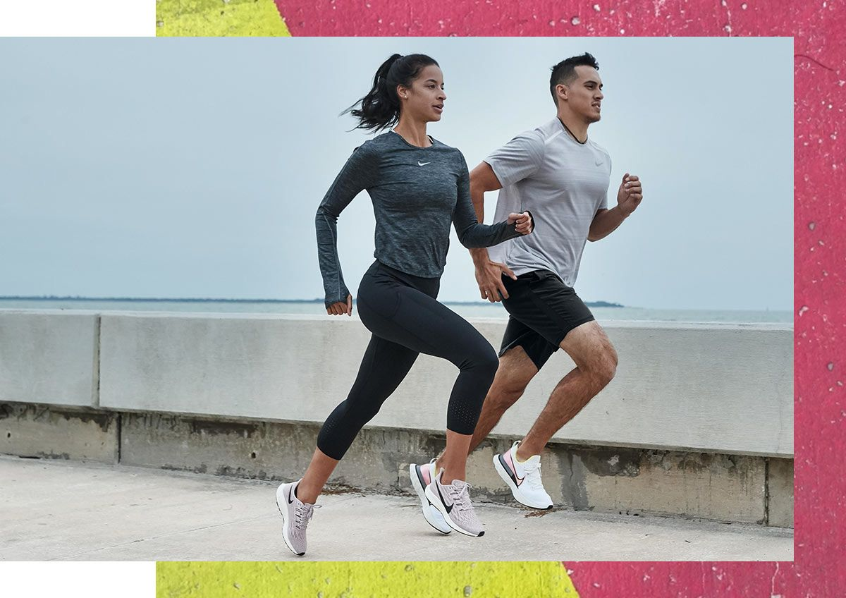 A couple running together in Nike workout clothes.