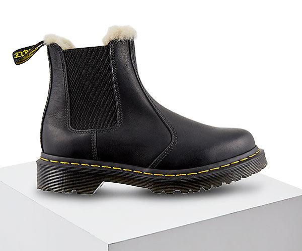 Image features Dr. Marten's boots.
