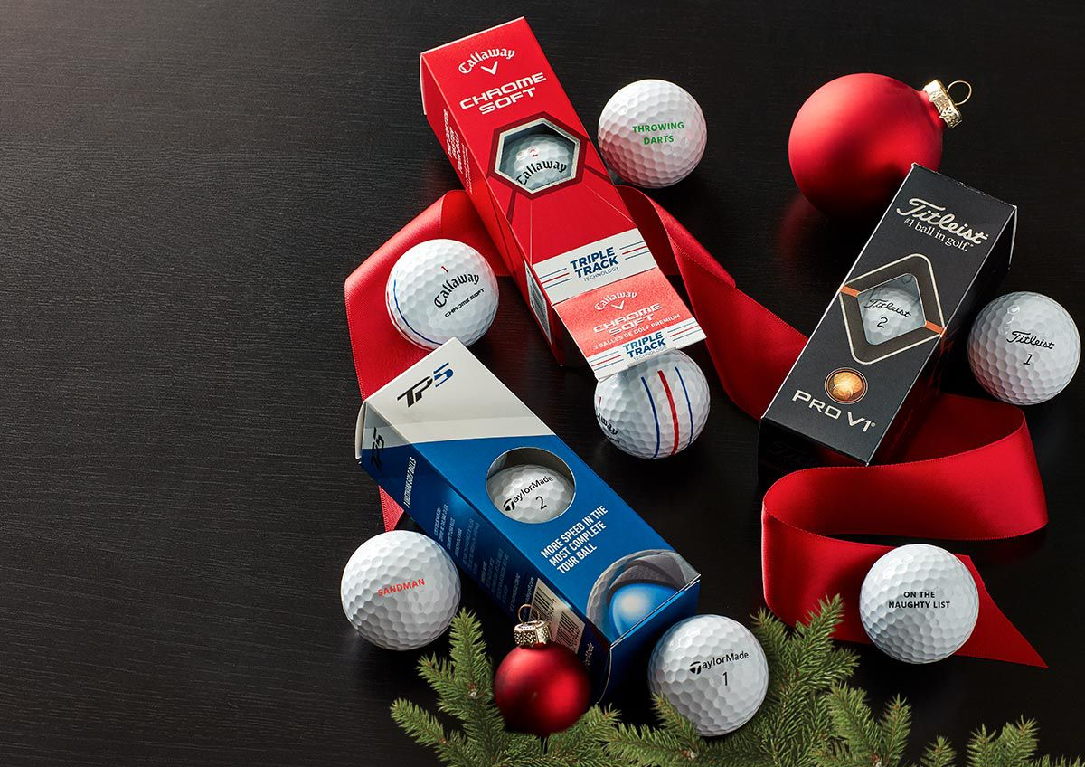 An Image Featuring Golf Balls With Personalized Messages