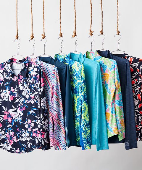 Colorful Styles Of Women's Sun Protection Golf Apparel Displayed On A Clothing Rack