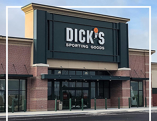 An Image of Dick's Sporting Goods Storefront on a sunny day.